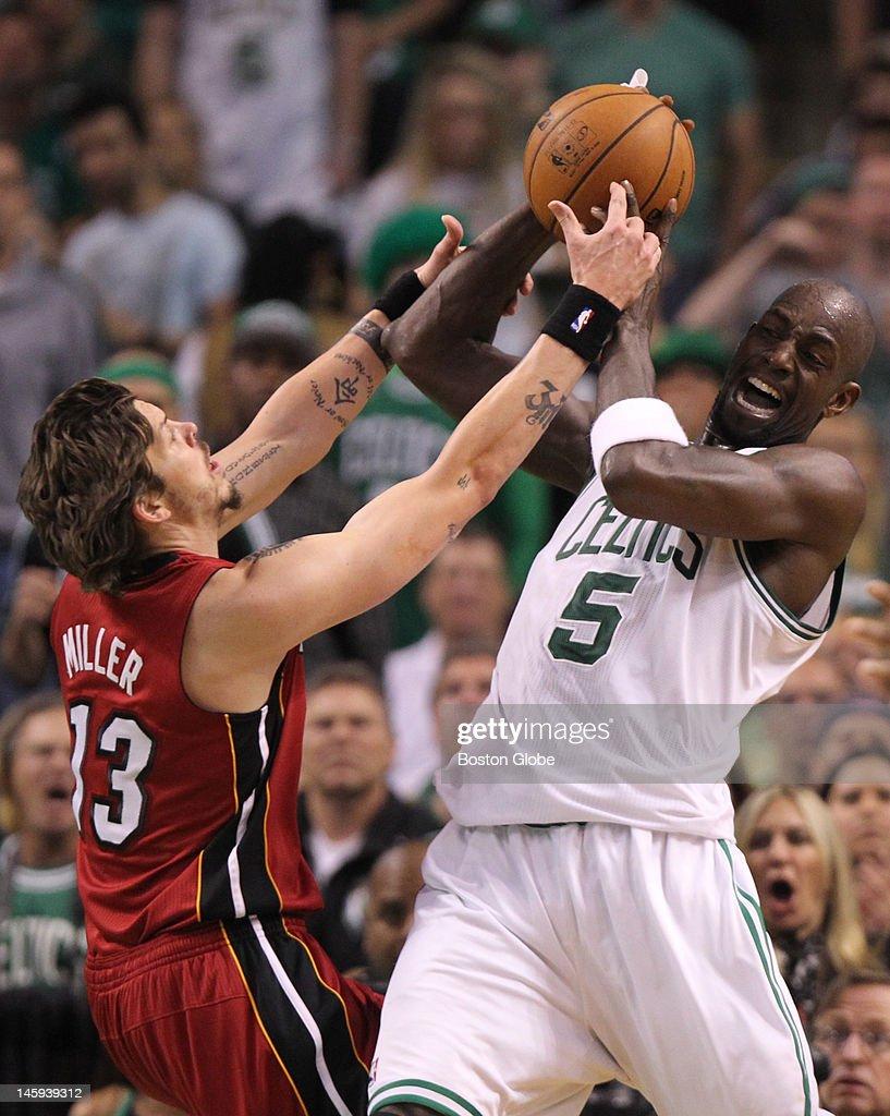 Boston Celtics power forward Kevin Garnett and Miami Heat shooting guard Mike Miller fight for the ball in the second quarter Boston Celtics NBA...