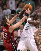 Boston Celtics power forward Kevin Garnett and Miami Heat shooting guard Mike Miller fight for the ball in the second quarter Boston Celtics NBA...