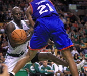 Boston Celtics power forward Kevin Garnett and Philadelphia 76ers small forward Thaddeus Young chase a rebound during the fourth quarter as the...
