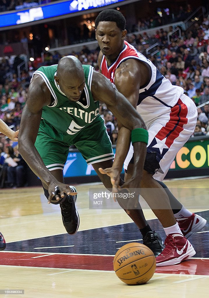 Boston Celtics power forward Kevin Garnett (5) and Washington Wizards power forward Kevin Seraphin (13) go after the ball during the first half of their game played at the Verizon Center in Washington, D.C., Saturday, November 3, 2012.