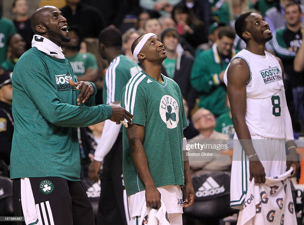 Boston Celtics power forward Kevin Garnett (#5), Boston Celtics shooting guard Jason Terry (#4) and Boston Celtics power forward Jeff Green (#8) watch the Gino video with the win in hand late in the fourth quarter. The Celtics play the Portland Trail Blazers at TD Garden.