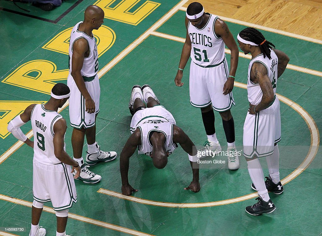Boston Celtics power forward Kevin Garnett (#5) does a series of knuckle pushups on the parquet to show he was ok after being thrown to the floor battling for a rebound. Boston Celtics NBA basketball, action and reaction. The Celtics play the Miami Heat in game three of the Eastern Conference Finals at TD Garden.