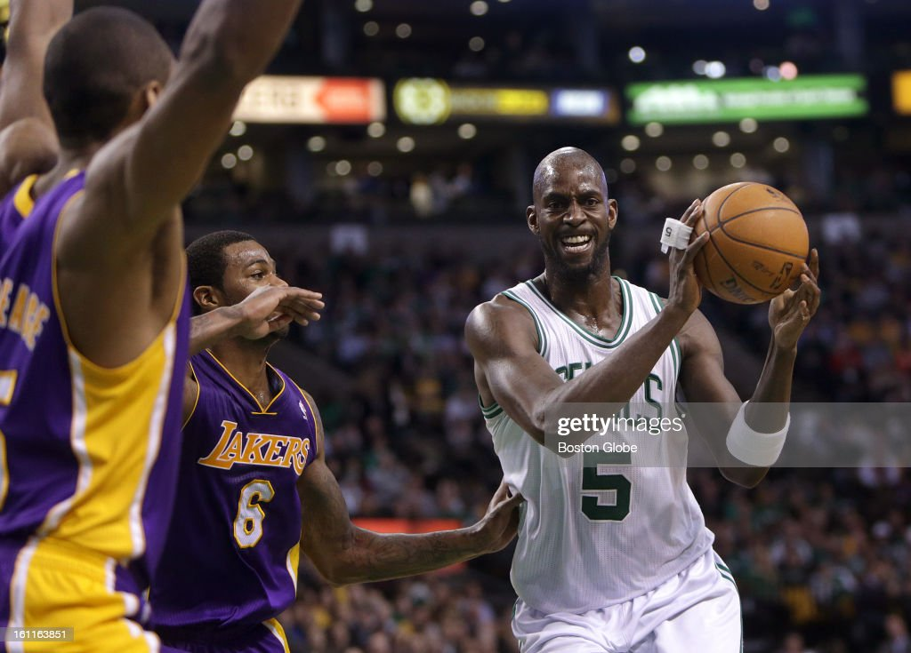 Boston Celtics power forward Kevin Garnett (#5) draws the double team as he drives to the basket during the second quarter as the Boston Celtics play the Los Angeles Lakers at TD Garden.