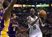 Boston Celtics power forward Kevin Garnett draws the double team as he drives to the basket during the second quarter as the Boston Celtics play the...