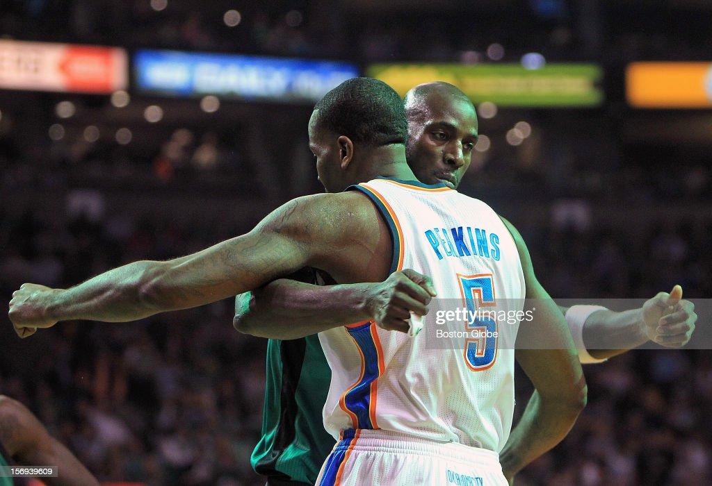 Boston Celtics power forward Kevin Garnett (#5) embraces former teammate Oklahoma City Thunder center Kendrick Perkins (#5) at the start of the game as the Celtics play the Oklahoma City Thunder at TD Garden.