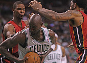 Boston Celtics power forward Kevin Garnett feels the pressure from the Miami Heat in the second quarter Boston Celtics NBA basketball action and...
