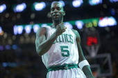Boston Celtics power forward Kevin Garnett gives his customary chest pounding at the start of tonight's game as the Boston Celtics play the Los...