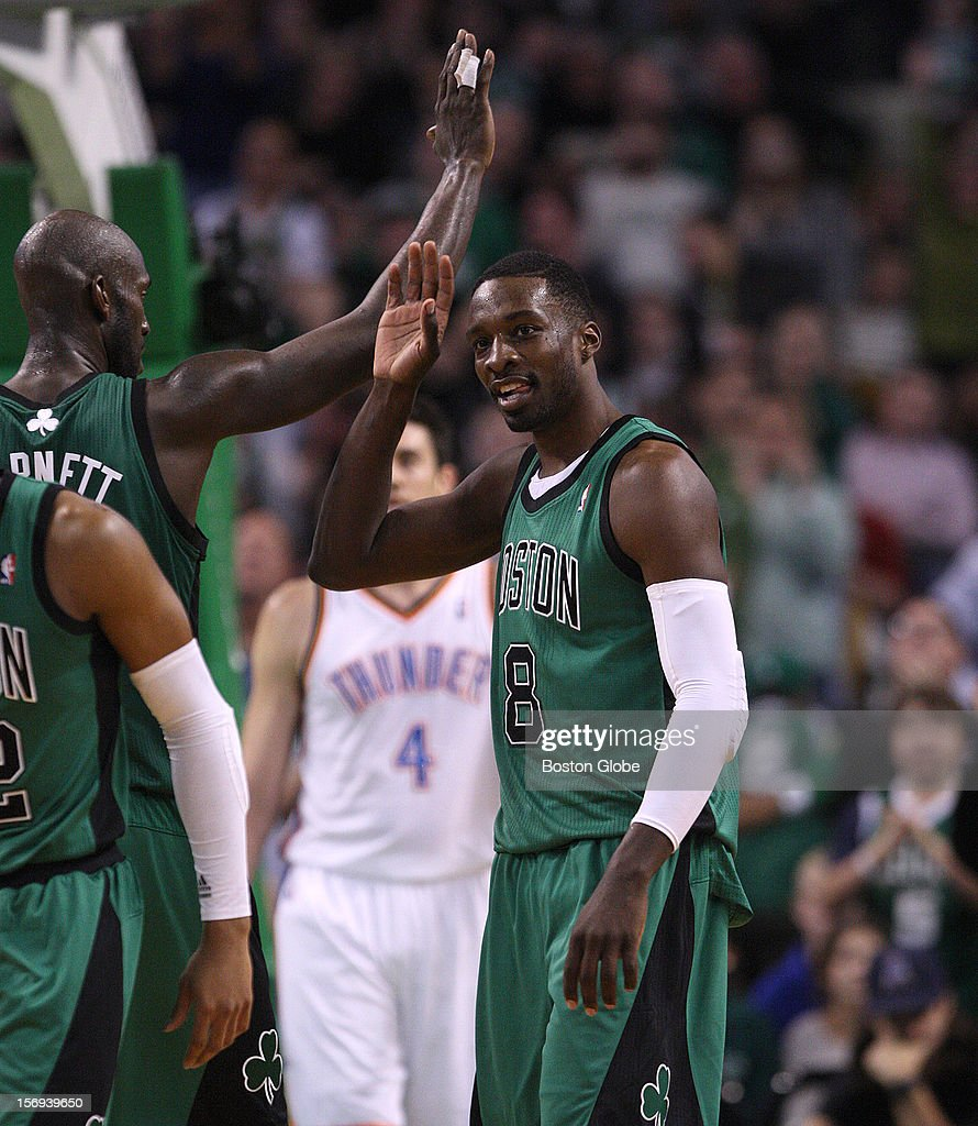 Boston Celtics power forward Kevin Garnett (#5) had a high five waiting for Boston Celtics power forward Jeff Green (#8) after Green drew a foul on a play in the third quarter as the Celtics played the Oklahoma City Thunder at TD Garden.
