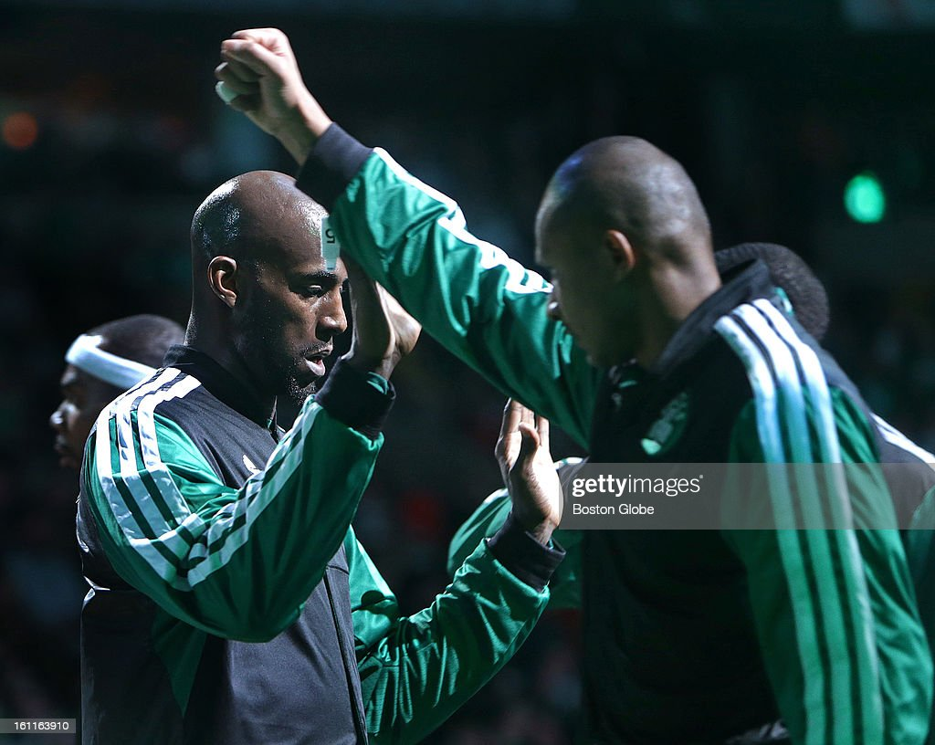 Boston Celtics power forward Kevin Garnett (#5) is greeted with high five's as he is introduced during the pre-game ceremonies before the Boston Celtics play the Los Angeles Lakers at TD Garden. Garnett has been the subject of trade rumors throughout the week.
