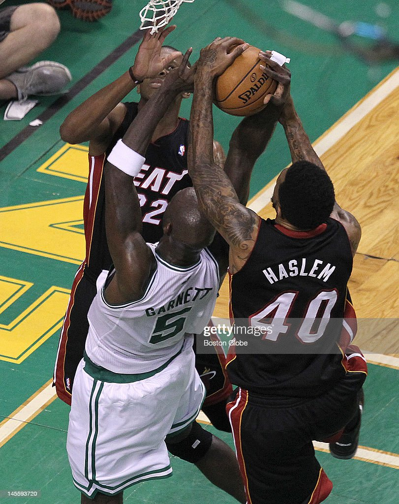 Boston Celtics power forward Kevin Garnett (#5) is thrown to the parquet floor while battling for a rebound with Miami Heat small forward James Jones (#22) and Miami Heat power forward Udonis Haslem (#40) in the second quarter. Boston Celtics NBA basketball, action and reaction. The Celtics play the Miami Heat in game three of the Eastern Conference Finals at TD Garden.