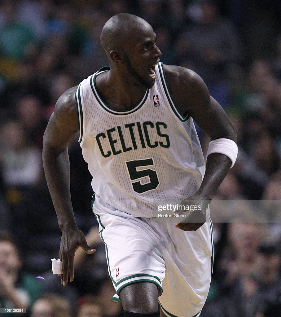 Boston Celtics power forward Kevin Garnett (#5) lets out a howl after sinking a shot to make it 52-32 in the third quarter as the Celtics play the Philadelphia 76ers at TD Garden.