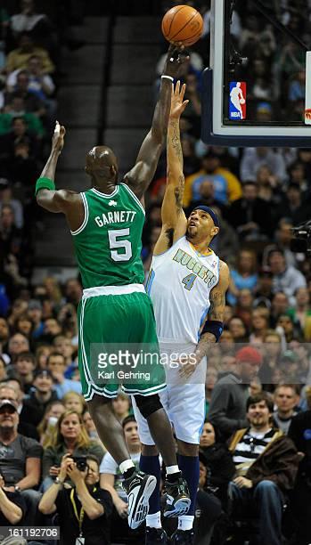 Boston Celtics power forward Kevin Garnett lofted a shot over Denver Nuggets power forward Kenyon Martin in the first quarter The Denver Nuggets...