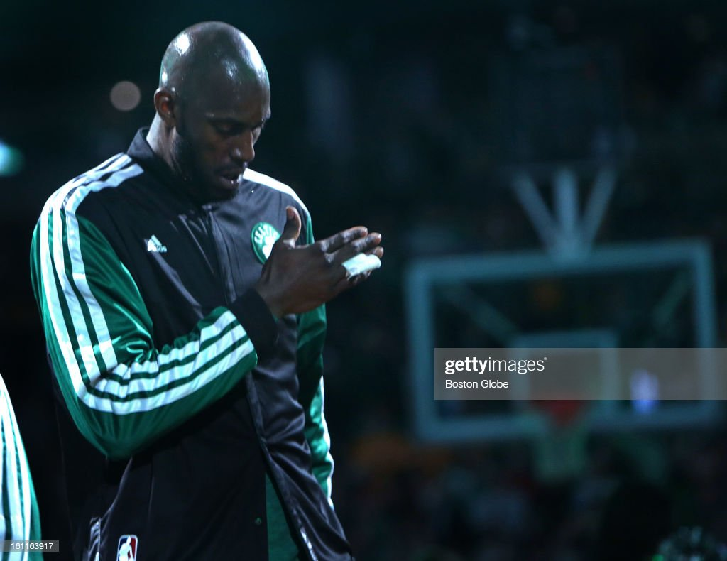Boston Celtics power forward Kevin Garnett (#5) pounds his chest as he is introduced during the pre-game ceremonies before the Boston Celtics play the Los Angeles Lakers at TD Garden. Garnett has been the subject of trade rumors throughout the week.