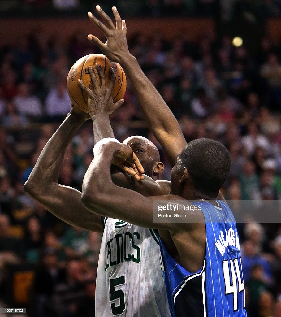 Boston Celtics power forward Kevin Garnett (#5) puts up a shot as Orlando Magic power forward Andrew Nicholson (#44) defends during the second quarter as the Boston Celtics take on the Orlando Magic at TD Garden.