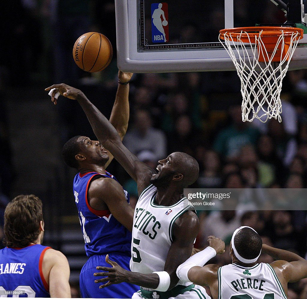 Boston Celtics power forward Kevin Garnett (#5) rejects a shot attempt by Philadelphia 76ers small forward Thaddeus Young (#21) during the second quarter as the Celtics play the Philadelphia 76ers at TD Garden.