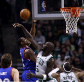Boston Celtics power forward Kevin Garnett rejects a shot attempt by Philadelphia 76ers small forward Thaddeus Young during the second quarter as the...