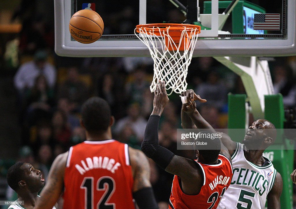 Boston Celtics power forward Kevin Garnett (#5) rejects this shot by Portland Trail Blazers center J.J. Hickson (#21) during the first quarter as the Celtics play the Portland Trail Blazers at TD Garden.