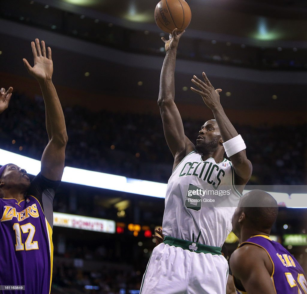 Boston Celtics power forward Kevin Garnett (#5) scores over Los Angeles Lakers center Dwight Howard (#12) on this shot in the second quarter as the Boston Celtics play the Los Angeles Lakers at TD Garden.