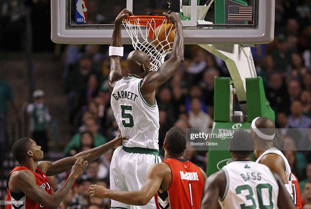 Boston Celtics power forward Kevin Garnett (#5) slams down a dunk during the third quarter as the Celtics play the Toronto Raptors at TD Garden.
