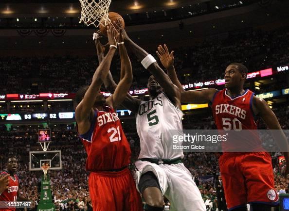 Boston Celtics power forward Kevin Garnett splits the defense of Philadelphia 76ers forward Thaddeus Young and Philadelphia 76ers power forward Lavoy...