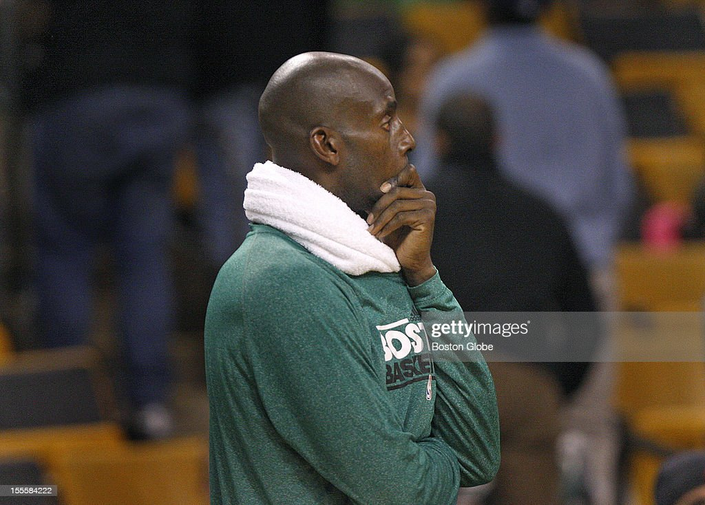 Boston Celtics power forward Kevin Garnett (#5) watches while the fans make their way to the exits as the time ran out during the fourth quarter as the Boston Celtics play the Milwaukee Bucks in their season home opener at TD Garden.