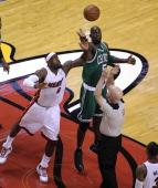 Boston Celtics power forward Kevin Garnett wins the opening tipoff against Miami Heat small forward LeBron James Boston Celtics NBA basketball action...