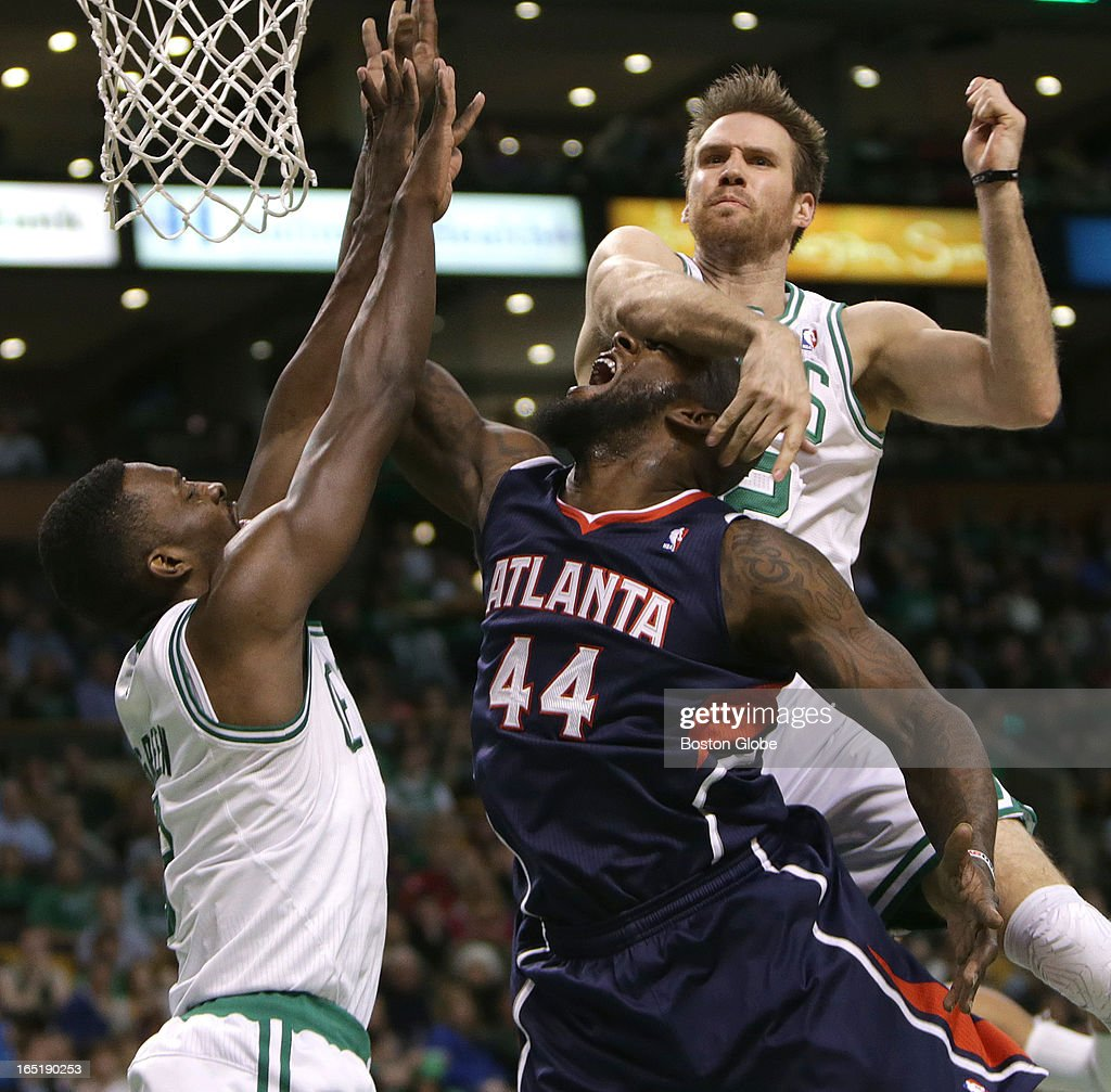 Boston Celtics power forward Shavlik Randolph (#42) makes contact with Atlanta Hawks power forward Ivan Johnson (#44) after seating away a shot attempt by Johnson during the second half. No foul was called on the play. The Boston Celtics play the Atlanta Hawks at TD Garden.