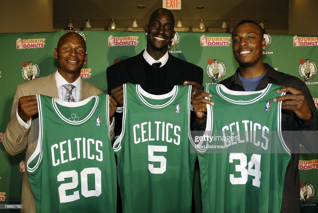Boston Celtics Ray Allen Kevin Garnett and Paul Pierce hold their jerseys after their press conference on July 31 2007 at the TD Banknorth Garden in...