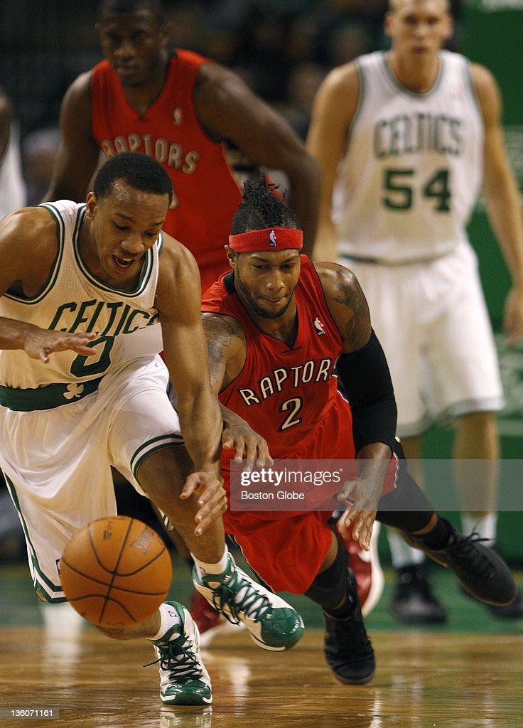Boston Celtics shooting guard Avery Bradley steals the ball from Toronto Raptors small forward James Johnson during the second quarter