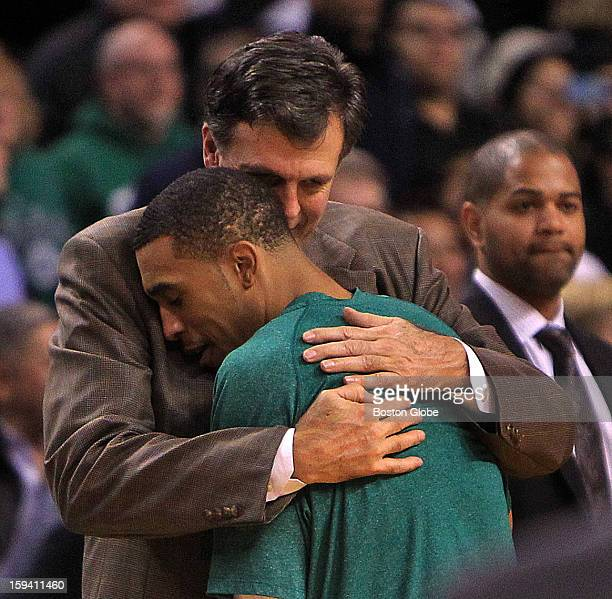 Boston Celtics shooting guard Courtney Lee and Houston Rockets head coach Kevin McHale share a moment at the end of the game as the Boston Celtics...