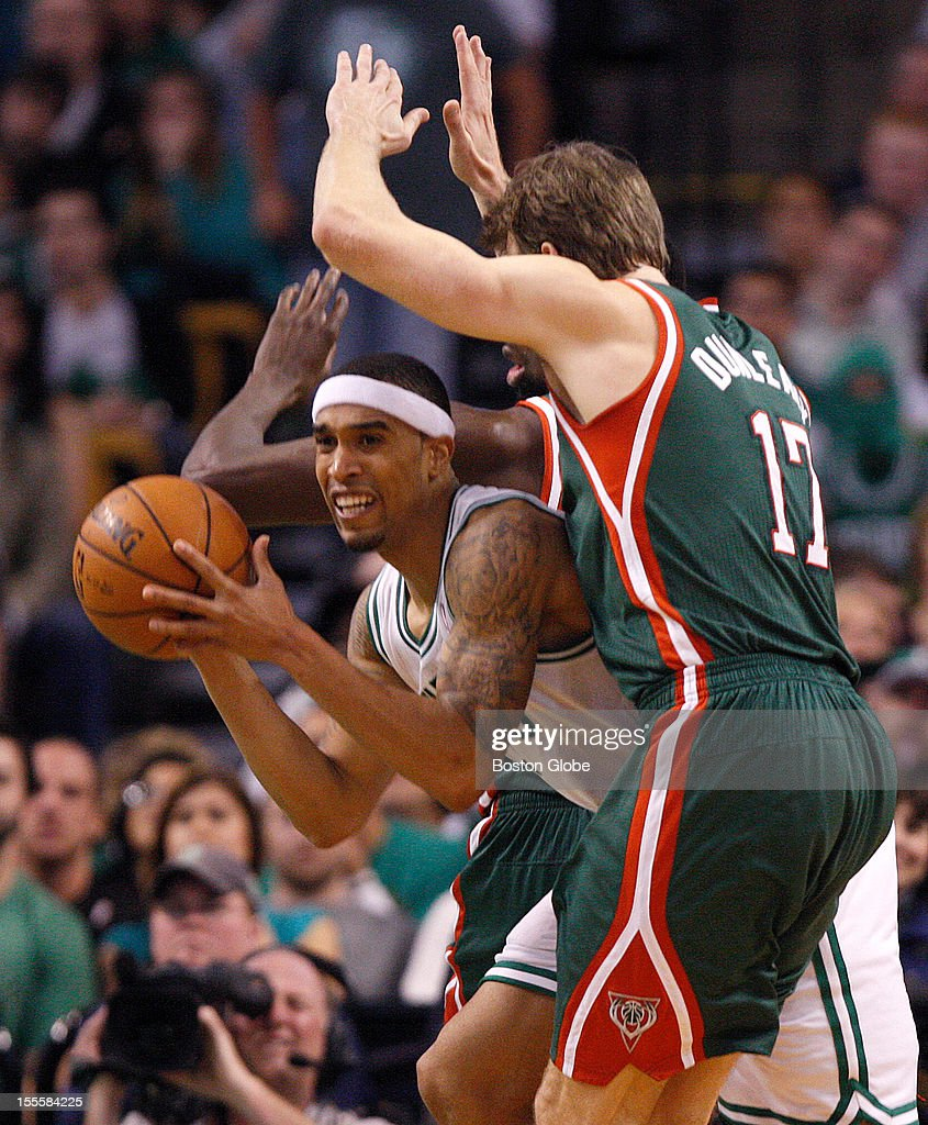 Boston Celtics shooting guard Courtney Lee (#11) looks for the outlet pass as he is double teamed during the fourth quarter as the Boston Celtics play the Milwaukee Bucks in their season home opener at TD Garden.