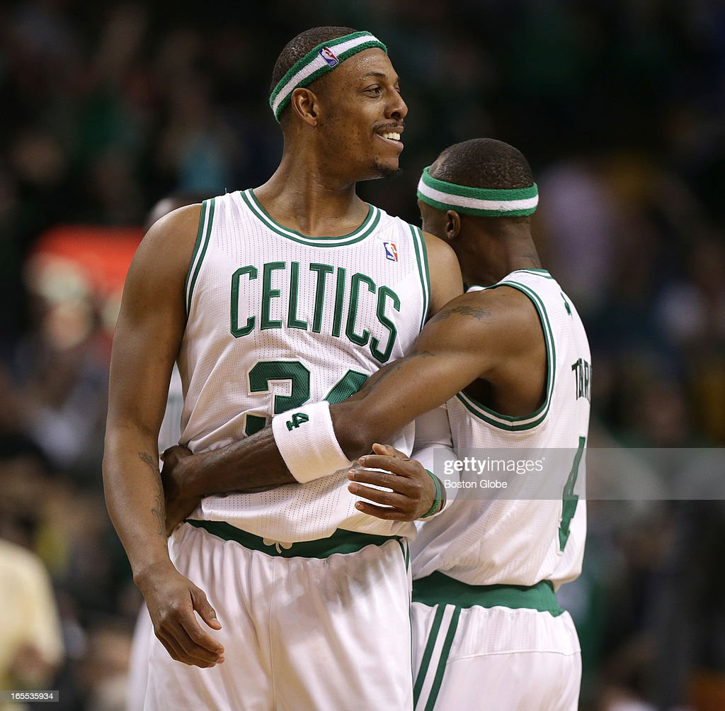 Boston Celtics shooting guard Jason Terry (#4) and Boston Celtics small forward Paul Pierce (#34) share a laugh and an embrace after Terry's missed three attempt was slammed home by Boston Celtics power forward Jeff Green (#8), not pictured, giving Boston a 91-83 lead in the fourth quarter. Celtics NBA basketball, action and reaction. The Celtics play the Detroit Pistons at TD Garden.