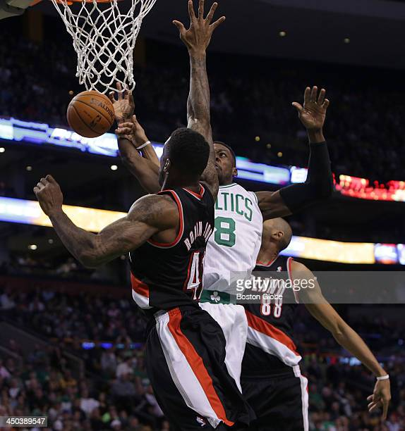 Boston Celtics shooting guard Jeff Green is fouled as he drive for a layup by Portland Trail Blazers power forward Thomas Robinson The Boston Celtics...
