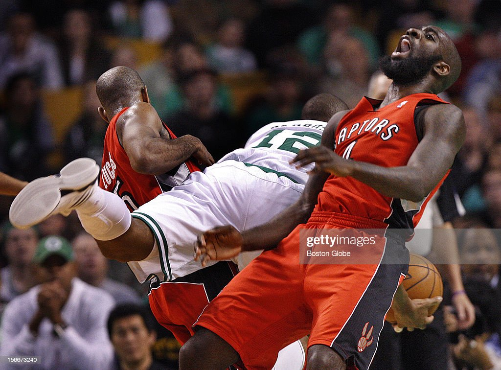 Boston Celtics shooting guard Leandro Barbosa (#12) is fouled by Toronto Raptors point guard John Lucas (#5) as he split the Toronto defense on a drive to the basket in the fourth quarter as the Celtics play the Toronto Raptors at TD Garden.