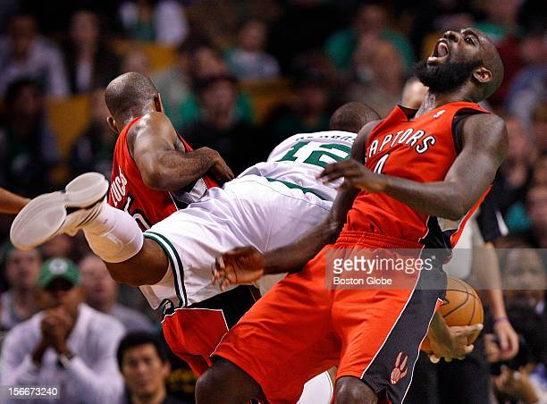 Boston Celtics shooting guard Leandro Barbosa is fouled by Toronto Raptors point guard John Lucas as he split the Toronto defense on a drive to the...
