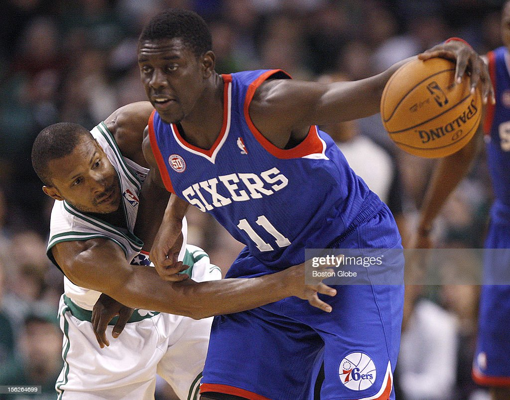 Boston Celtics shooting guard Leandro Barbosa (#12) was called for the foul on Philadelphia 76ers point guard Jrue Holiday (#11) during the second quarter as the Celtics play the Philadelphia 76ers at TD Garden.