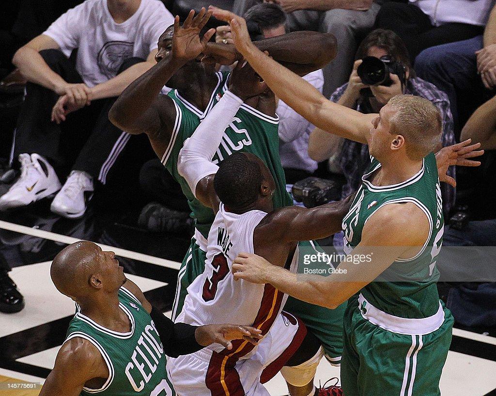 Boston Celtics shooting guard Ray Allen Boston Celtics power forward Brandon Bass and Boston Celtics center Greg Stiemsma defend Miami Heat shooting...