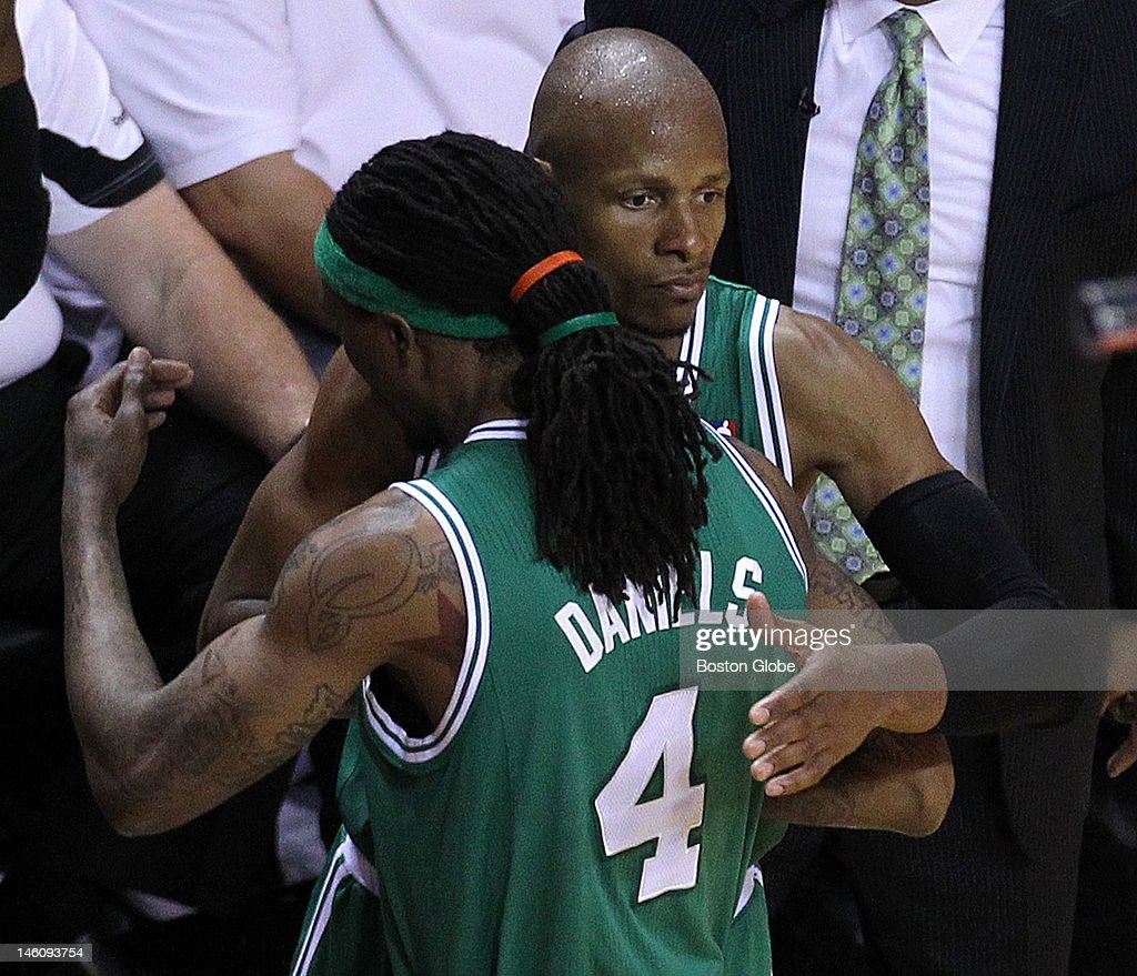Boston Celtics shooting guard Ray Allen shares a hug with Boston Celtics shooting guard Marquis Daniels in the closing moments of the fourth quarter...