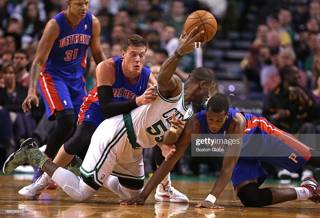 Boston Celtics shooting guard Terrence Williams (#55) gets off a pass as he battles Detroit Pistons power forward Jonas Jerebko (#33) and Detroit Pistons small forward Khris Middleton (#32) for a loose ball in the second half. Celtics NBA basketball, action and reaction. The Celtics play the Detroit Pistons at TD Garden.