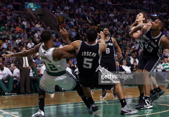 Boston Celtics small forward Chris Johnson and Boston Celtics center Kelly Olynyk are tied up with San Antonio Spurs point guard Cory Joseph and San...