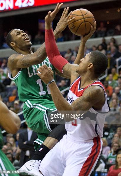 Boston Celtics small forward Chris Johnson drives to the basket against Washington Wizards shooting guard Bradley Beal during the first half of their...