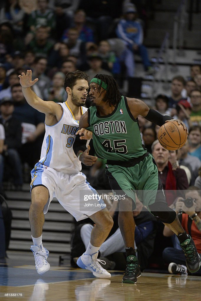 Boston Celtics small forward Gerald Wallace (45) is guarded closely by Denver Nuggets shooting guard Evan Fournier (94) during the first quarter January 7, 2014 at Pepsi Center.