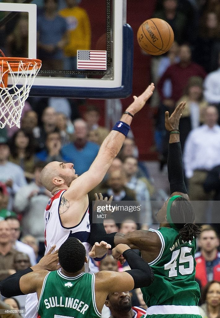Boston Celtics small forward Gerald Wallace (45) shoots and makes the game-winning shot over Washington Wizards center Marcin Gortat (4) during overtime of their game played at the Verizon Center in Washington, Wednesday, Jan. 22, 2014. Boston defeated Washington 113-111 in overtime.
