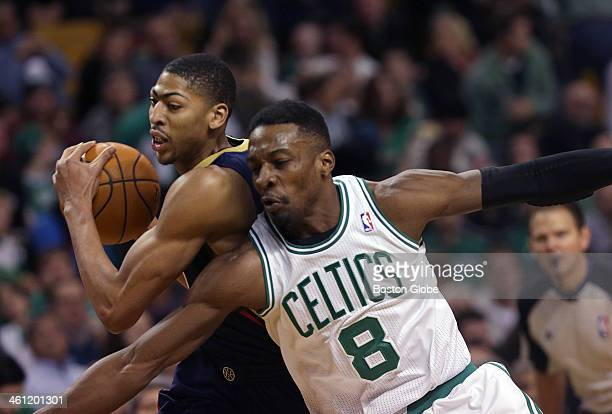 Boston Celtics small forward Jeff Green fouls New Orleans Pelicans power forward Anthony Davis after losing the ball on a turnover to Davis in the...