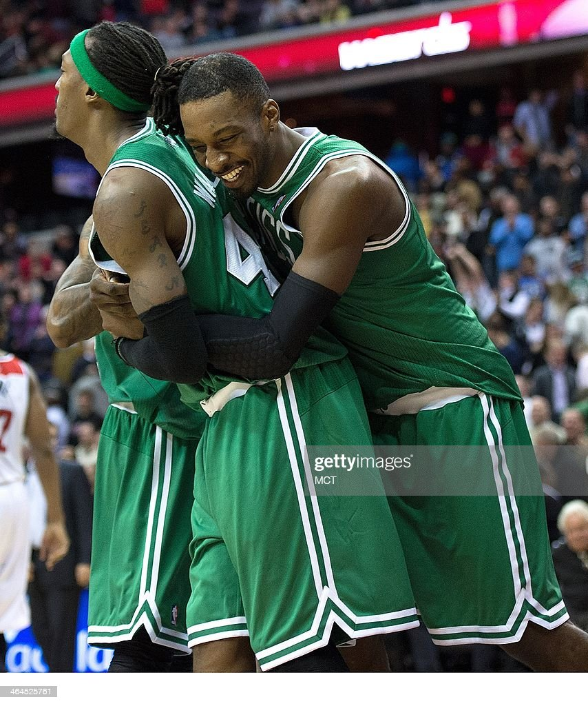 Boston Celtics small forward Jeff Green (8) hugs teammate Boston Celtics small forward Gerald Wallace (45) following their overtime victory over the Washington Wizards played at the Verizon Center in Washington, Wednesday, Jan. 22, 2014. Boston defeated Washington 113-111 in overtime.