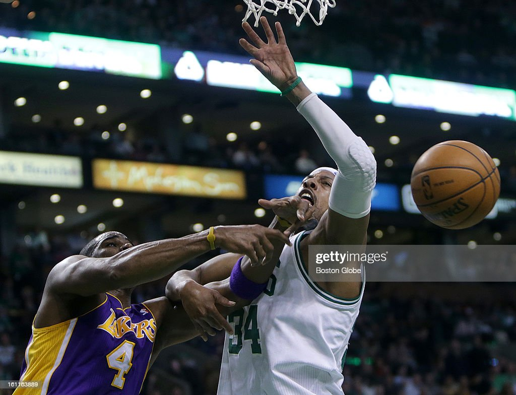 Boston Celtics small forward Paul Pierce (#34) and Los Angeles Lakers power forward Antawn Jamison (#4) battle for a rebound in the third quarter as the Boston Celtics play the Los Angeles Lakers at TD Garden.