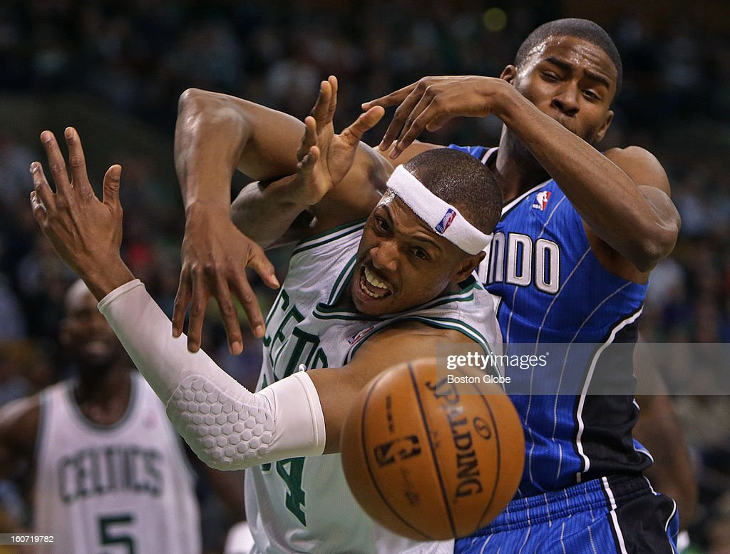 Boston Celtics small forward Paul Pierce (#34) and Orlando Magic small forward Moe Harkless (#21) battle for a rebound in the third quarter as the Boston Celtics take on the Orlando Magic at TD Garden.