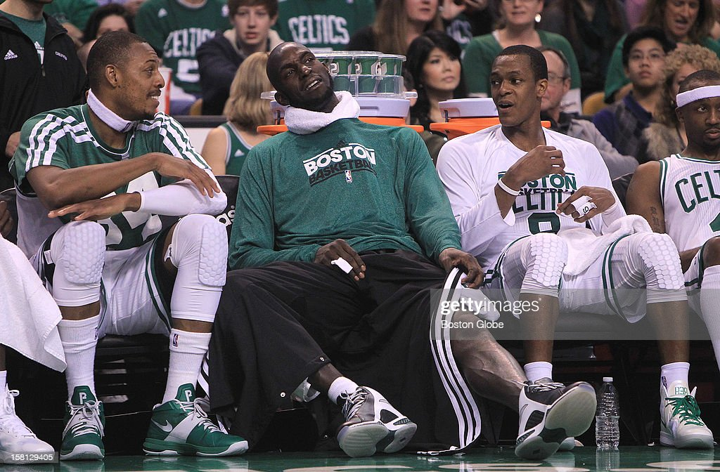 Boston Celtics small forward Paul Pierce (#34), Boston Celtics power forward Kevin Garnett (#5), and Boston Celtics point guard Rajon Rondo (#9) had some time to savor the win from the bench in the fourth quarter as the Celtics play the Philadelphia 76ers at TD Garden.