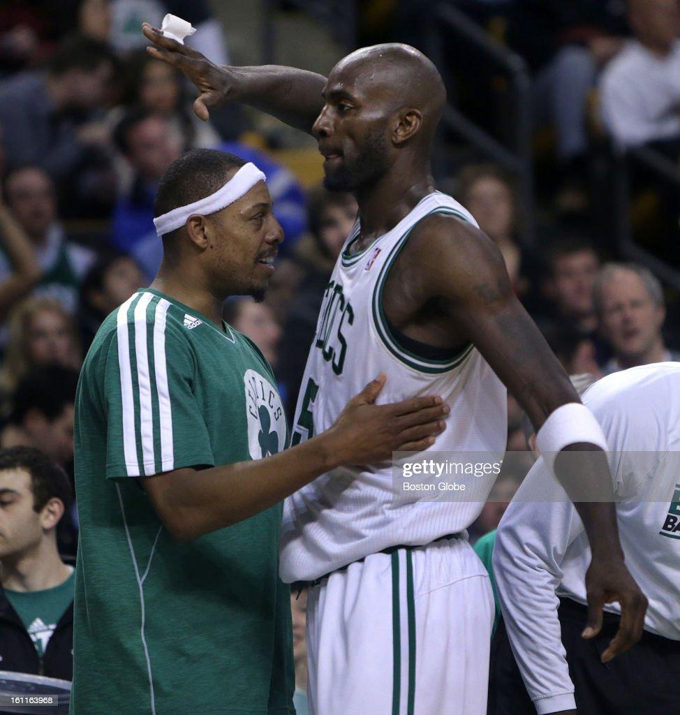 Boston Celtics small forward Paul Pierce (#34) greets Boston Celtics power forward Kevin Garnett (#5) as Garnett came out of the game in the fourth quarter as the Boston Celtics play the Los Angeles Lakers at TD Garden.