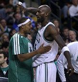 Boston Celtics small forward Paul Pierce greets Boston Celtics power forward Kevin Garnett as Garnett came out of the game in the fourth quarter as...